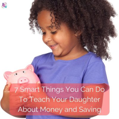 young girl putting coin into a piggy bank