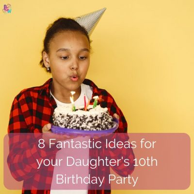 young girl blowing out candles on a birthday cake