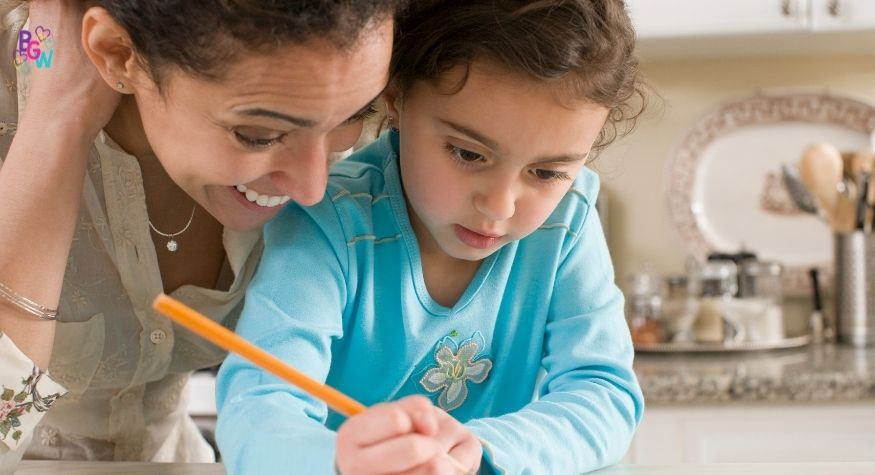 mother and daughter writing together