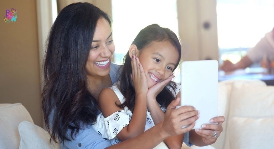 young girl and mother looking at a tablet
